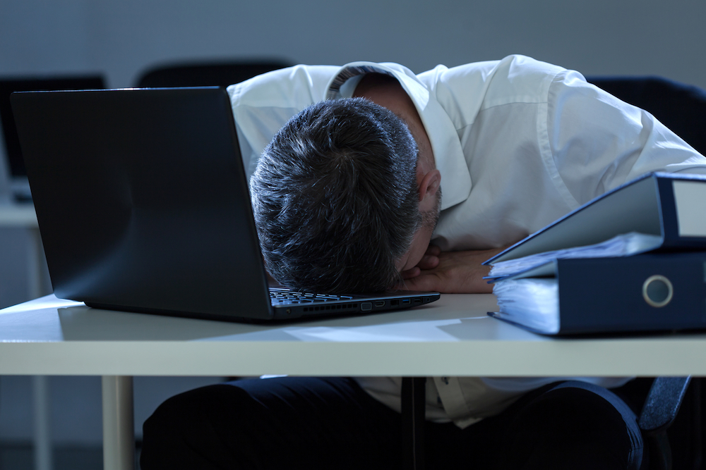 Businessman overwhelmed by problems at work