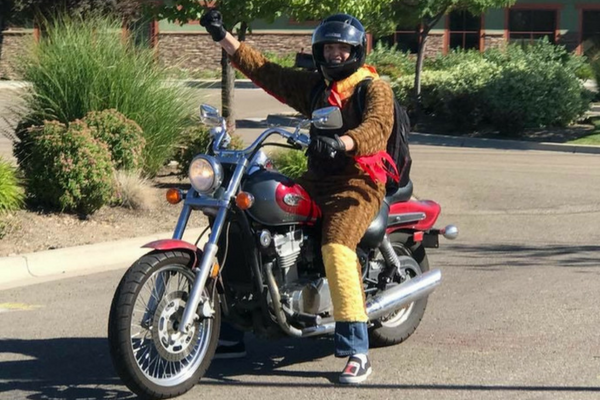 Stephen Larsen on motorcycle in chicken outfit