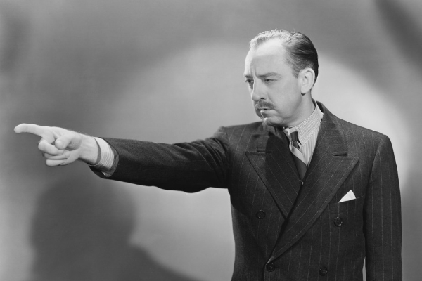 Man pointing in black and white