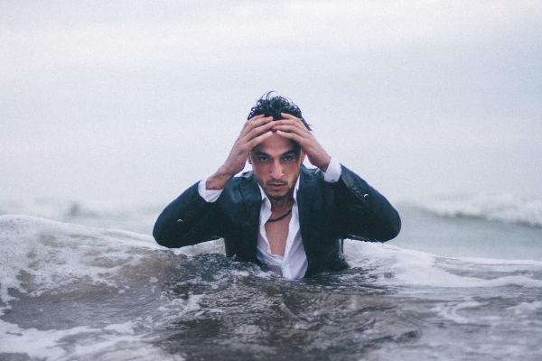 man in water wearing a suit