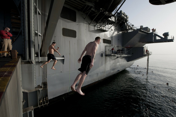 man jumping off ship