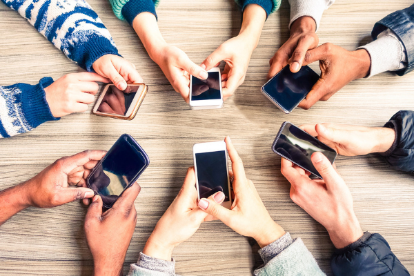 people on their phones in a circle
