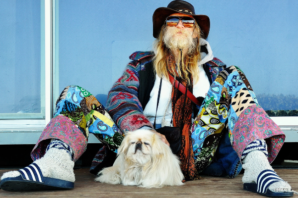 man with long hair and dog